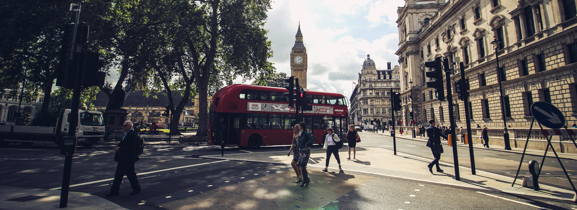 Photograph of a London Street, featuring Big Ben and a red double-decker bus in the background.